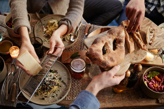 Group of friends having dinner together inside a cabin