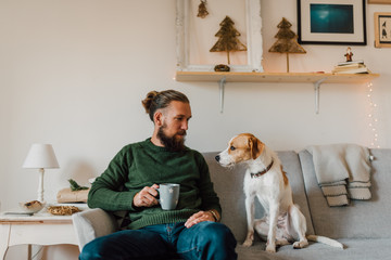 Portrait of a young bearded man and his dog