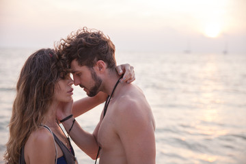 Sensual portrait of young couple at the beach