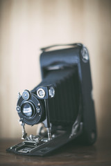 Antique film camera on wooden table