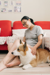 Pregnant woman and her dog at home