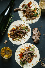Beef tortillas on table with beer Seen from above