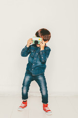 Little boy taking photo with diy camera