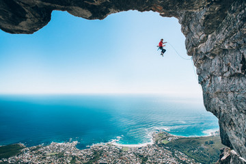 Rock climber taking a fall on Table Mountain, Cape Town