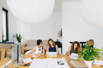 Female designer team working in a beautiful studio