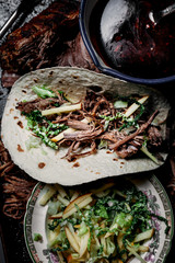Pulled beef and apple slaw tortilla with barbecue sauce Seen from above