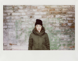 A young woman on the street, scan of instant film