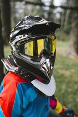 Motocross rider with helmet portrait