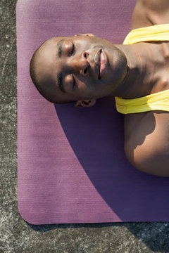 Young dark skinned man relaxing after a successful workout