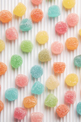 Colourful sugar candy on white background