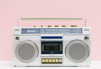 Retro ghetto blaster tape deck over pastel pink background
