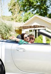 Woman Enjoying Ride With Man In Convertible