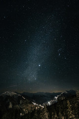 milky way above snowcovered austrian mountains