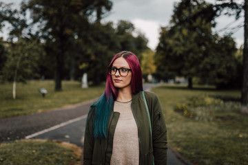 Young stylish woman standing outdoor