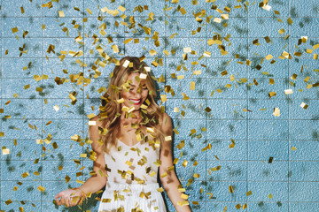 Portrait of Woman Covered With Golden Shining Confetti