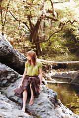 Beautiful redhead woman relaxing in nature in California