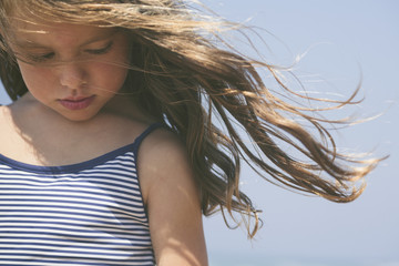 Wind blowing into a child`s hair