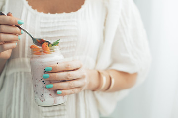 Woman Eating Strawberry Yoghurt