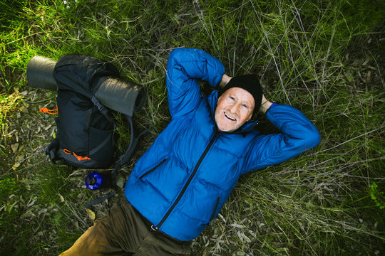 Senior mountaineer resting in the grass from above