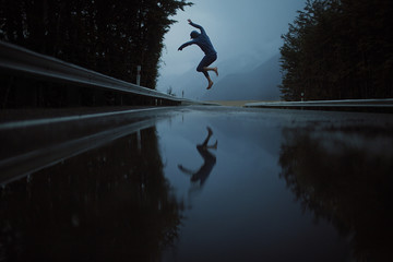 rowdy young man puddle jumps in the early hours of the morning