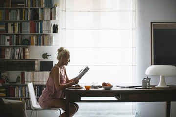 Caucasian Woman Reading a Magazine in the Morning