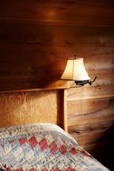 Bedroom inside rustic wood cabin