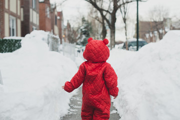 Toddler running in the snow