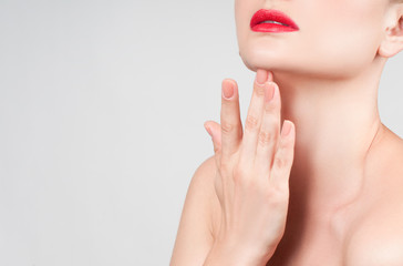 Beautiful woman neck with clean skin and red lips
