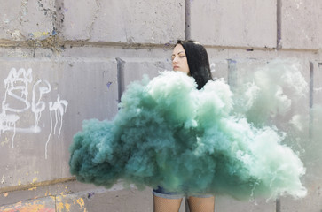 real girl with green smoke bomb