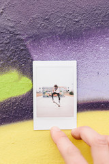 Instant Photo of Female Skateboarder Against Colorful Wall