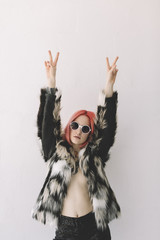 Cool young woman with pink hair