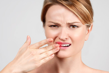 Woman feeling strong toothache.