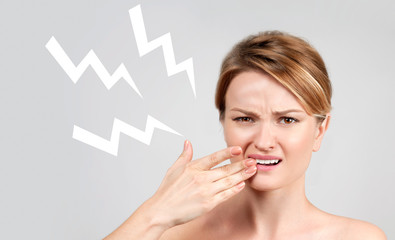 Closeup of woman suffering from toothache