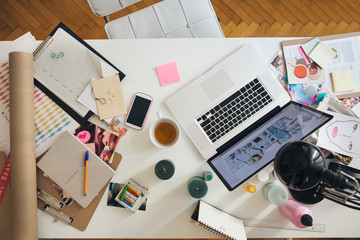 Modern Businesswoman's Messy Desk