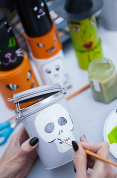 Cans being decorated for halloween games