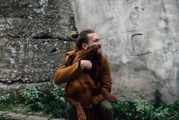 Portrait of man playing with his dog
