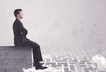 Sitting salesman on rooftop solving maze