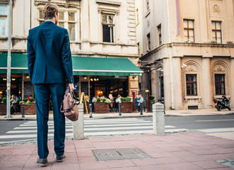Caucasian Businessman Walking on the Street
