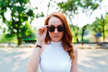 Redhead woman portrait with sunglasses