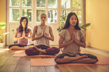 Three women meditating