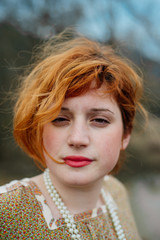 Portrait of young beautiful ginger woman