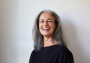 Portrait of beautiful senior woman with grey hair indoors