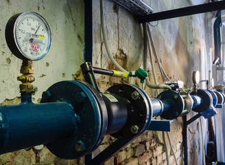 Heat-regulating equipment in the basement of a heated building / Photo taken in Russia. Heating systems for apartment houses and heat meters