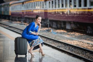 Beautiful Thai girl in Thai costume,Asian woman wearing traditional Thai culture at train station,Bangkok.