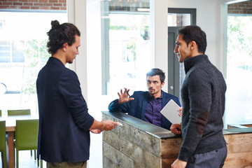 Three millennials meeting at work at the office