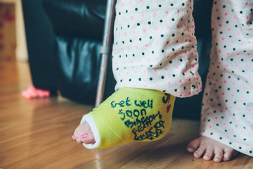 Teenage girl with a cast on her broken foot