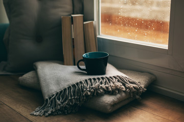 Coffee time in a cozy home on a rainy day