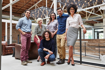 Group portrait of millennials in high tech office