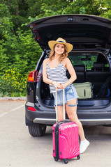 Vacation, travelling - woman ready for the travel for summer vacation