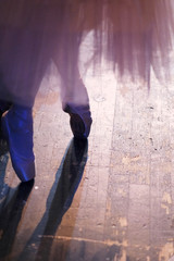 Legs of a ballerina in pointe shoes before going on stage